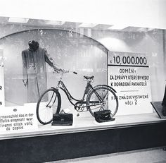 "Window of Baťa shop in Wenceslas Square, Prague, where the Nazis after the assassination exposed the personal belongings of assassins. Inscription on the right: ""10,000.000 koruns of rewarding for news leading to capture of the assassins. Who knows belongings displayed here?"""