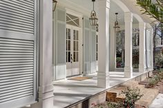 Door Shutters- columns---- steps out front Possibly remove side glass and put in French doors?