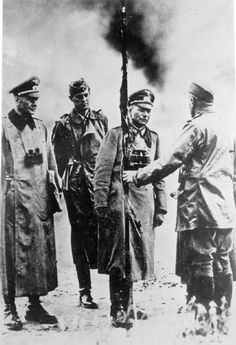 Generaloberst Heinz Guderian (1888 - 1953): Generaloberst Heinz Guderian, seen here when he was General der Panzer Truppen, receiving the charred remains of a captured French Army standard, during a lull in the fighting in France in 1940.