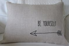 This hand drawn, hand-embroidered and handmade pillow cover with its classic saying of Be Yourself with an arrow is sure to make a statement on your couch or chair. This pillow is a lovely accent pillow and would make a great gift for a child in your life.  The pillow cover is 12 x 18 inches (pillow form insert is NOT INCLUDED - can be found on Etsy or online) and is embroidered in black with Be Yourself saying with an arrow underneath on 100% natural linen (greyish tan) medium weight…