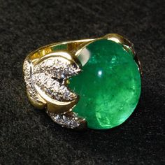 Columbian Dream Ring (2013)  Marlene Stowe is the designer of this rare and very beautiful ring. The 36.29 ct emerald is impressive in size and the color is a clear, intense bright green.  Style is modern and wearable.Natural cabochon cut emerald, weight is 36.29 ct; Believed to be of Columbian provenance; 70 round brilliant cut diamonds, total weight is 1.75 ct; H-I color grade, VS clarity grade; 18 kt yellow gold