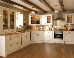 Kitchens - Burford Gloss Cream – Burford – Kitchen Families – Kitchen Collection – Howdens Joinery Co - Cream Kitchen Units, Cream Gloss Kitchen, Cream Kitchen Cabinets, Cream Country Kitchen, Cream Cupboards, White Cabinets, Cream And Oak Kitchen, Cream Shaker Kitchen, Kitchen Black