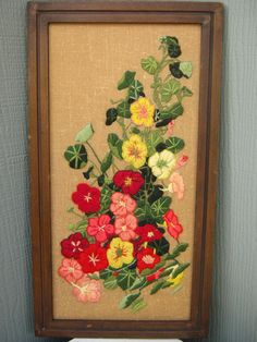 This is beautiful vintage crewel needlework of garden flowers - the prettiest pinks, rose colors and soft yellows and whites worked on a tea colored