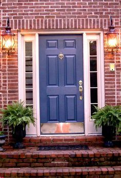 blue door on brick house - Google Search