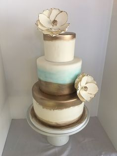 Gold hand painted with sugar flower three tier wedding cake. #peridotsweets