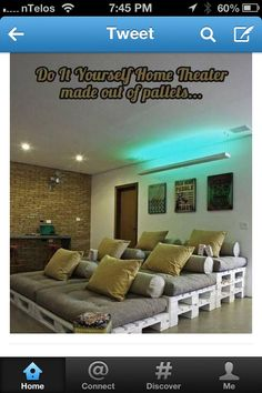 DIY home theater with pallets can use twin mattress and outdoor cloth to have indoor/outdoor theater.