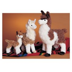 """At 7"""" tall, featuring soft golden brown fur with a white face, legs, and chest, this little llama stuffed animal is certain to be an instant favorite. - Ages: 24 Months & Up - Washing Instructions: Ma"""