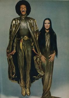 Sly Stone and Kathy Silva wearing their wedding outfits designed by Halston, June 1974.