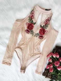 Features: Mesh body Floral embroidered patch Mock neck Open shoulders Long sleeves Comes in Blush
