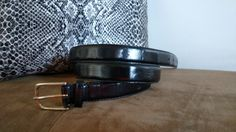 Check out this item in my Etsy shop https://www.etsy.com/listing/277989628/vintage-mundi-eelskin-black-narrow-belt