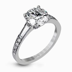 This dazzling white gold wedding set is enhanced by .21 ctw round cut white diamonds with side accents of .53 ctw of baguette cut diamonds.