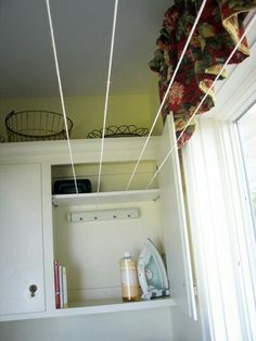 Love this way of adding drying space in a small laundry room! Tuck a retractable clothesline in to your laundry room cabinets to maximize your line drying space. Laundry Room Remodel, Laundry Room Cabinets, Laundry Room Organization, Laundry Storage, Laundry Room Design, Laundry In Bathroom, Organization Hacks, Basement Laundry, Bathroom Plumbing