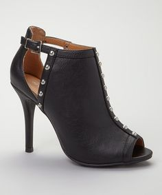 A confident stride starts with fashionable feet and ends with a fearless attitude. The spiked heel and peep-toe cutout of this bootie adds instant edge, while a slim buckle defines the vamp.
