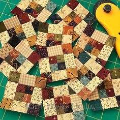 """Just when you think nothing can top your 2"""" Pinwheels, the scrappy 2"""" Nine-Patch blocks come along and kick their hineys to the curb. #KimDiehlQuilts #IttyBittyBlocks #HelpingHandsPrints #HenryGlassFabrics"""