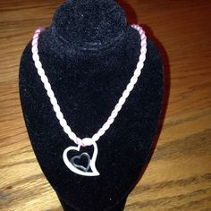 "NWOT 16"" Pink Twisted Satin Double Heart Necklace Gorgeous polished and silver satin finished open heart dangle hanging from a 16"" Pink Twisted Satin Necklace. Open heart diameter is approximately 0.8"" at the widest and hangs down 1"". Jewelry Necklaces"
