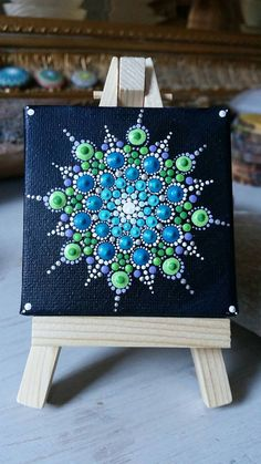 Miniature snowflake dot art Dotilism canvas mandala on easel