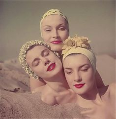 Models wearing swimming caps, 1950s.