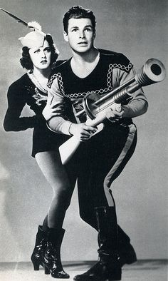 """1936--Flash Gordon (Larry """"Buster"""" Crabbe) and Dale Arden (Constance Moore)."""