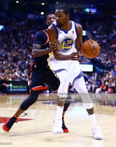 857829619 Kevin Durant of the Golden State Warriors dribbles the ball as Delon Wright  of the Toronto Raptors defends during the second half of an NBA game at Air  ...