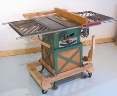 Mobile Table Saw Base by Matthias Wandel -- Homemade mobile table saw base actuated via the lifting moment generated by ball bearings rolling in an inclined slot. http://www.homemadetools.net/homemade-mobile-table-saw-base