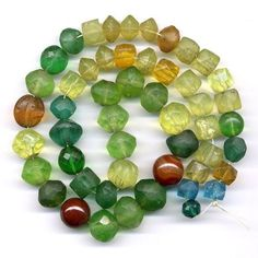 Antique Trade Beads Mixed Lot of Vaseline Uranium by eastofoz. Photo under normal light.
