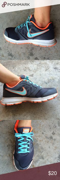 Women's Nike's Women's Nike running shoes used condition. Dark gray, neon orange, and baby blue. Size 8 Nike Shoes Athletic Shoes