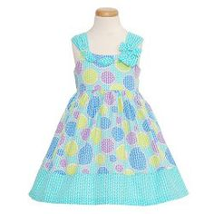 A beautiful summer dress for your baby or toddler girl by Bonnie Jean. This summer, circle print dress has a smaller dot pattern throughout....