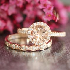 This morganite wedding ring set showcases a halo engagement ring with a 7mm round cut natural morganite set in a solid 14k rose gold halo diamond setting. To complete the gorgeous look, a matching scalloped diamond wedding band is created to be paired with this elegant halo morganite ring!  ** Engagement Ring: https://www.etsy.com/listing/245480469/rose-gold-morganite-engagement-ring-in  ** Wedding Band: https://www.etsy.com/listing/208657354/vintage-inspired-matching-diamond…