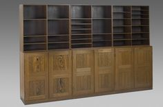 "Mogens Koch Bookshelves  Designer:	 Koch, Mogens Producer:	Rud Rasmussen Year:	'50s Size:	See below Object no:	6926 Originally designed in 1933. Rare example in Wegné wood. Adjustable shelves. Paper label Rud Rasmussens Snedkerier 45 Nörrebrogade Köpenhavn.  Upper section h.81cm/31.9"" d.36cm/14.2"" w.76cm/29.9"" Lower section h.76cm/29.9"" d.27cm/10.6"" w.76cm/29.9"""