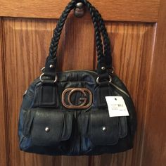 Guess Purse New black Guess purse, medium to large size, see photo, it is hanging on my closet door. Guess Bags Shoulder Bags