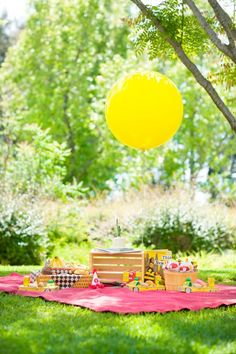 A helium balloon at a picnic? Where are the people?