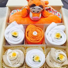 This cupcake gift set will be adored by any little baby girl or boy! Featuring a gorgeous Tigger comforter from the very popular and famous Winnie the Pooh story. Comes presented in a white or ivory gift box tied in a bow with orange ribbon.