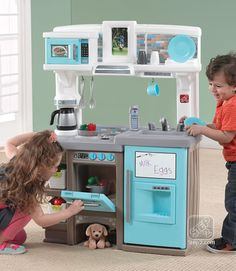 Plastic Play Kitchen Step 2 the step2 grand walk-in kitchen will turn your toddler's playroom