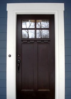 Love everything about Craftsman style. Deep stain on a Craftsman door