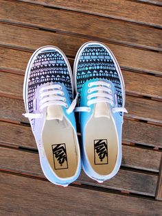 These custom hand-painted, one-of-a-kind hand-painted Authentic Vans have been painted pastel colors. A black tribal design has been painted over