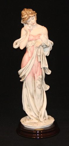 Item DescriptionTitle:Giuseppe Armani Florence Art Sculpture The Dreamer 1374P Lady with Doves BirdsDescription:Made in Italy. Rose (pinkish) colored dress. Size: 12.5 inches high. Condition: Excellent; no chips or cracks; includes original box. Stock Number: A009035 Terms of Sale Buy It Now: If this item has a Buy It Now option, then we have reviewed comparable sale prices on eBay for this item and have established a Buy It Now price based on our research. If you feel the price is fair…