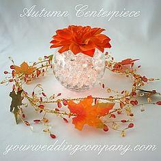 Silk fall leaves placed on a beaded garland -  wedding centerpiece - www.yourweddingcompany.com