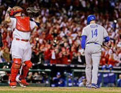 St. Louis Cardinals catcher Yadier Molina reacts after Los Angeles Dodgers second baseman Mark Ellis strikes out to end the NLCS. (Jeff Roberson/AP)