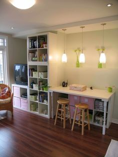 I really like the desk idea with the Ikea cubes under and the pendent lights above desk