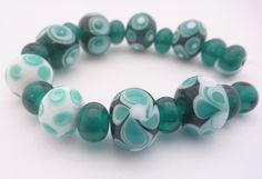 Lampwork Glass Bead Set in teal and white. 19 beads, 8 design beads and 11 transparent spacers. Artisan lampwork, SRA, Chrys Art Glass by ChrysArtGlass on Etsy