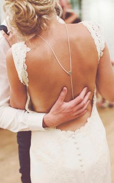If you're opting for a backless wedding dress, accessories it with a statement necklace.