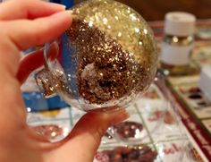 Glitter ornaments using dollar store MOP & GLOW!!  So easy and pretty!