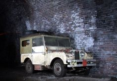 A Collapsed Old Railway Tunnel Hides These Rare Cars, including a Land Rover Series 1! Click to read more.