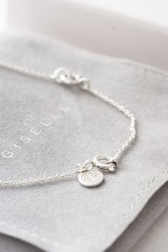 all our jewelry come with our Giselle Symbol Logo tag!  #gisellejewelry #silver #necklace