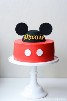 mickey mouse birthday cake with handmade fondant mickey hat - vanilla cakes with sliced strawberries and whipped cream filling frosted with bright red tinted cream cheese buttercream