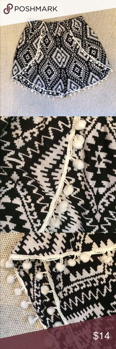 BLACK&WHITE TRIBAL PRINT SHORTS WITH WHITE TRIM BLACK&WHITE PRINT SHORTS WITH CUTE WHITE POMPOM TRIM ON FRONT AND AROUND LEGS! 100% rayon/ELAST WAISTBAND. BLUE ISLAND Shorts