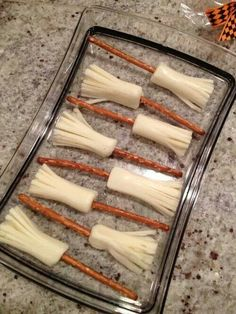 Witches Brooms made with pretzel sticks and string cheese.