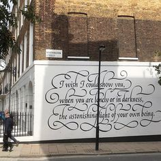 Elegant Calligraphy Mural Greets Passersby With an Uplifting Quote From a 14th Century Poet