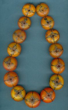 "Antique African ""Amber"" beads that have been decorated with silver by Mauritanian silversmiths 