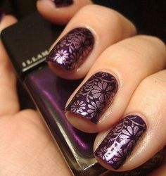 Purple and flower nails.